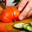 Stock Photo: Cutting vegetables