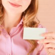 Business woman holding her visiting card — Stock Photo