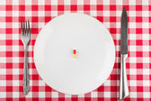Pill on a plate — Stock Photo