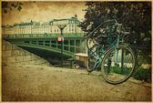 Romantic bridge and bike in Paris. Vintage photo — Стоковое фото