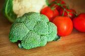 Broccoli, Cauliflower, tomato on the wooden board — Stock Photo