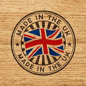 Made in the UK. Stamp on wooden background — Stock Vector