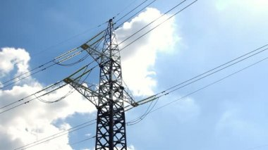 High voltage tower and cables against blue sky — Stock Video