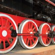 Red wheels of the old express steam train — Stock Photo