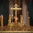 Stock Photo: Candles in darkness against Orthodox cross