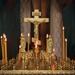 Candles in the darkness against the Orthodox cross — Stock Photo