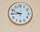 Retro wall clock on old ackground — Stok fotoğraf