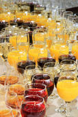 Glasses of juice and wine at the banquet — Stock Photo