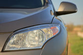 Car headlight close-up — Stock Photo