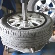 Mechanic removes car tire closeup — Stock Video