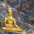 Buddhist golden statue man meditating — Stock Photo