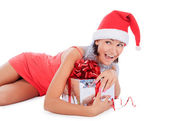 Santa woman lie with gift box over white — Stock Photo