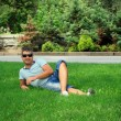 man relaxing on the grass — Stockfoto