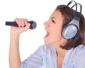 Female singing in to microphone. — Stock Photo