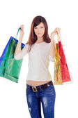 Young female with colour shopping bags over white — Stock Photo