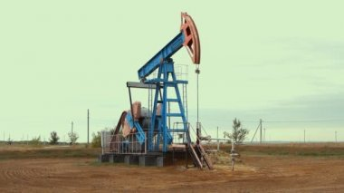 Work of oil pump jack on a oil field. — Stock Video