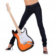 Sexy female body with electric guitar against white background — Stock Photo #42710759