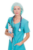 Medical doctor woman with stethoscope and clipboard — ストック写真