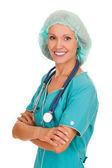 笑みを浮かべて、白い背景で隔離された女性の医者 — ストック写真