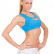 Beautiful young fitness trainer standing isolated on white backg — Stock Photo