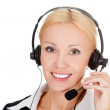 Cheerful call center operator against white background — Stock Photo #12632817