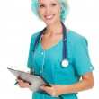 Medical doctor woman with stethoscope and clipboard — Stock Photo #12672118