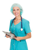 Medical doctor woman with stethoscope and clipboard — Stock Photo