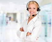 Woman wearing headset in office — Stock Photo