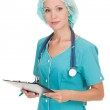 Confident medical doctor woman with stethoscope and clipboard — Stock Photo #13329947