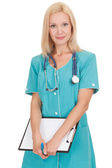 Smiling medical doctor woman with stethoscope and clipboard — Stock Photo