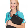 Smiling medical doctor woman with stethoscope and clipboard — Stock Photo #13830234
