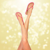 Female legs with pink flip-flops — Stock Photo