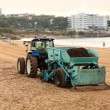 Tractor on a beach of Salou, Spain - Stock Photo