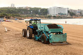 Tractor on a beach of Salou, Spain — Stock Photo
