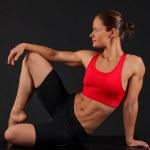 Sporty woman on black background — Stock Photo #15621195