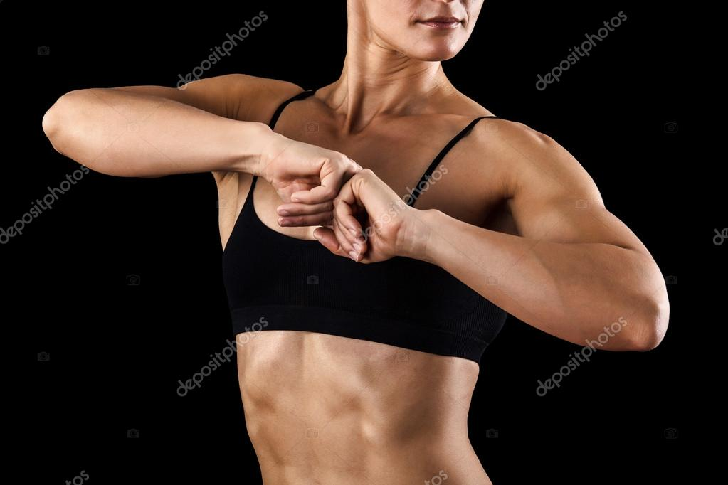 Muscular female body against black background. — Stock Photo #15824789