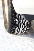 Car wheel on a white snow — Stock Photo