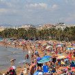 People on a beach in Salou, Spain - Stok fotoğraf