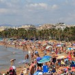 People on a beach in Salou, Spain - Stockfoto