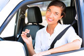 The happy girl showing the key of her new car — Stock Photo