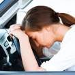 Girl sleeps in a car — Stock Photo