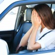 Crying woman in a car — Stock Photo
