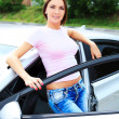 Woman standing by car — Foto Stock