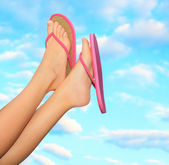Female legs in pink sandals — Stock Photo