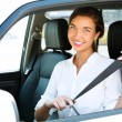 Attractive young woman in a car fastens seat belt — Stock Photo