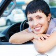 Smiling senior woman in a car — Stock Photo