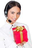 Call center operator with a gift box — Stock Photo