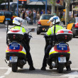 Policemen on bikes watching the crowd at the Plaza de Espana — Stock Photo