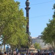 People walk by at the famous La Rambla — Stock Photo