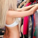 Woman in a wardrobe — Stock Photo